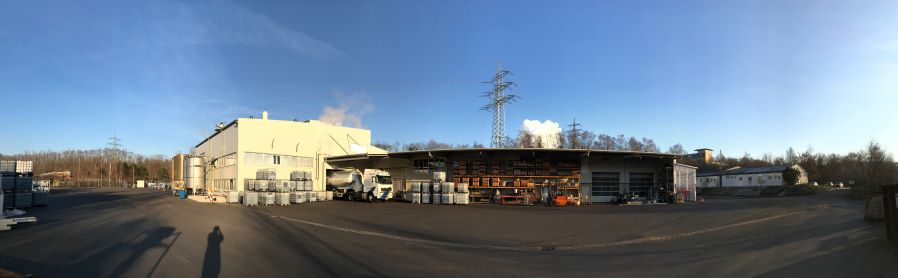 panoramic outdoor view of the humintech company site with loading gate and storage facilities